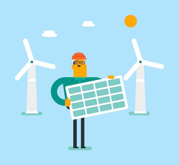 Молодой кавказский белый человек держа панель солнечных батарей.