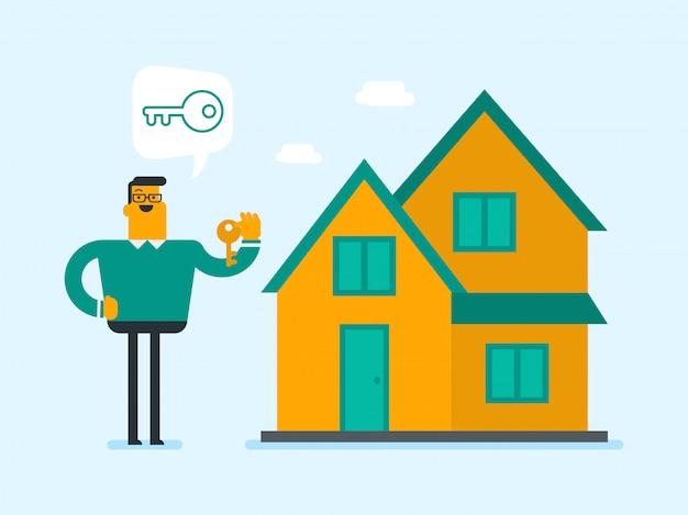 Молодой кавказский белый домовладелец держит ключ.