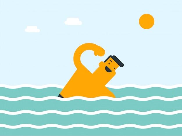 海で泳いでいる若い白人の白人男性。