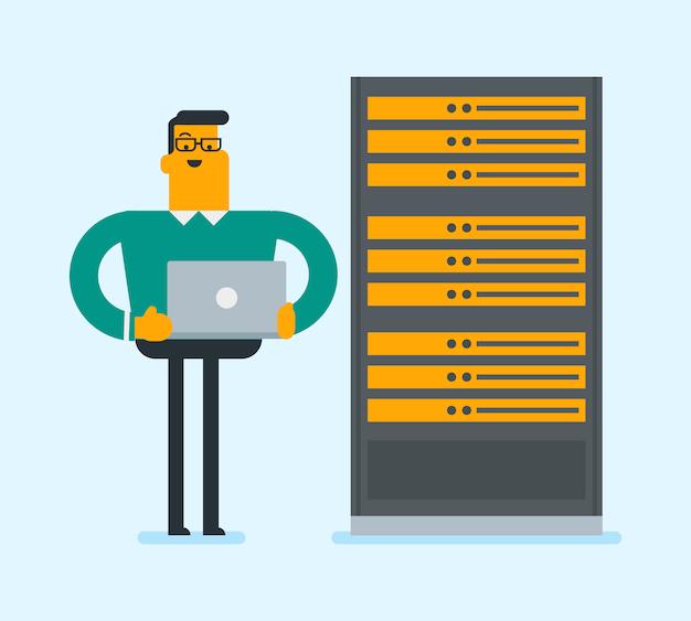 ネットワークサーバールームでラップトップに取り組んでいるエンジニア。