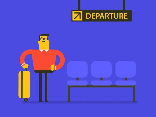 Кавказский человек с чемоданом в ожидании рейса.