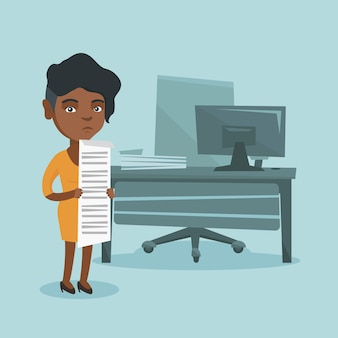 長い法案を保持している若いアフリカの会計士。