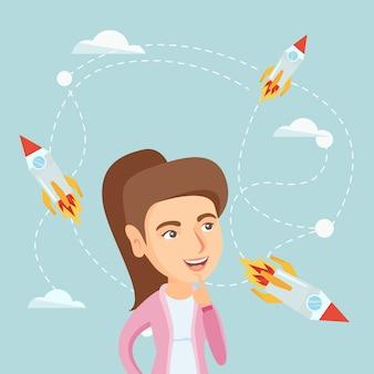 Кавказская деловая женщина смотрит на летающие ракеты