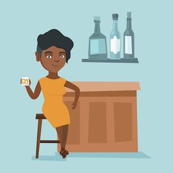 バーに座っている若いアフリカ人女性のカウンター。