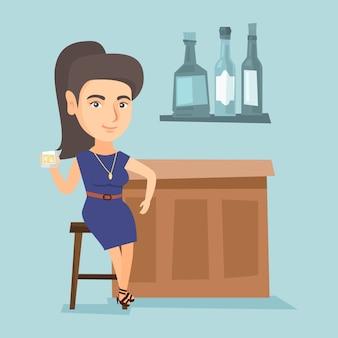 バーに座っている若い白人女性のカウンター。