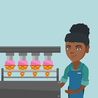 アイスクリームを生産する工場のアフリカ人労働者。