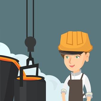 Сталевар в каске за работой в литейном цехе.