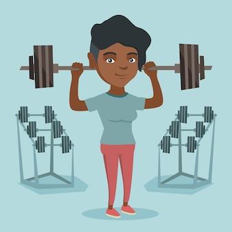 バーベルを持ち上げる若いアフリカ系アメリカ人女性。