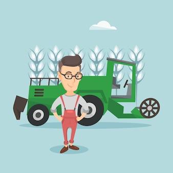 コンバインで立っている農夫