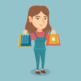 買い物袋を保持している若い白人女性。