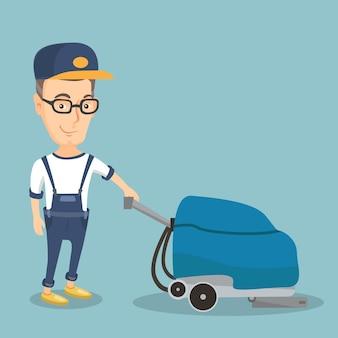 マシンで店の床を掃除する男。