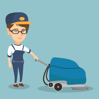 マシンで店の床を掃除する女性。