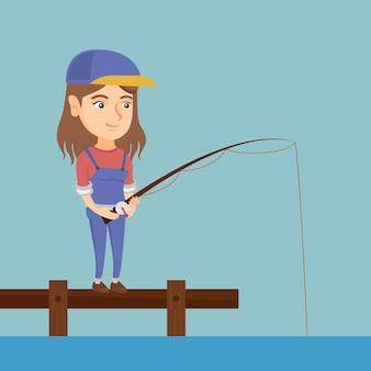 若い白人女性が桟橋で釣り。