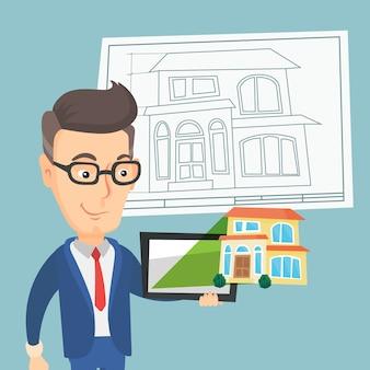 タブレットコンピューターで家の写真を見せている男。