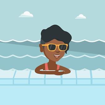 スイミングプールでリラックスした若いアフリカ人女性。