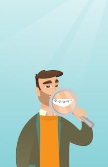 拡大鏡で彼女の歯を調べる人。