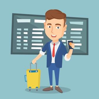 空港でスーツケースとチケットを持つ男。