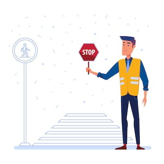 横断歩道の前に一時停止の標識を持つ交通警備員。