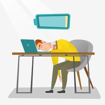 Уставший работник спит на рабочем месте.