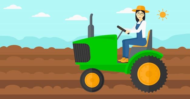 農家の運転トラクター。