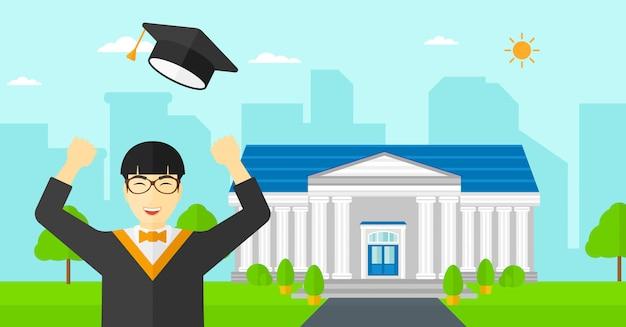 彼の帽子を投げる卒業生