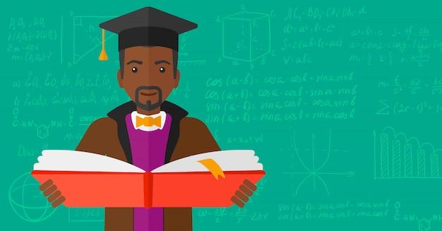 本を持って卒業キャップの男