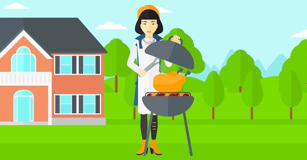 バーベキューを準備する女性