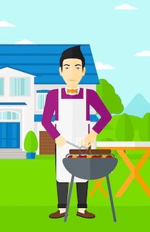Мужчина готовит барбекю