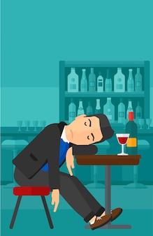 バーで寝ている男