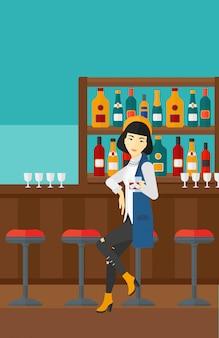 バーに座っている女性