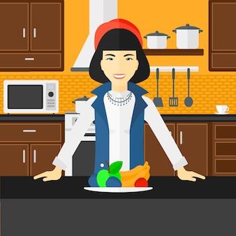 健康食品を持つ女性。