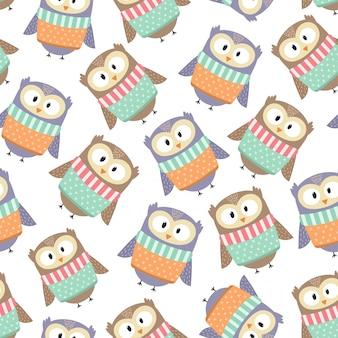 冬服かわいいフクロウはシームレスパターンです。ベクトルイラスト