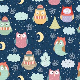 クリスマスのための夜のシームレスパターンで面白い冬フクロウ