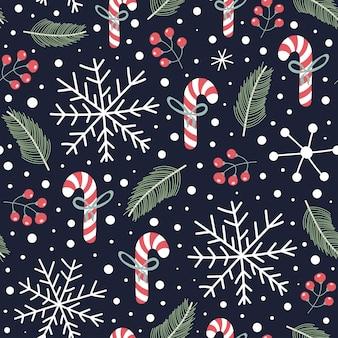 クリスマスのお菓子、スノーフレーク、モミの枝、果実と休日のシームレスパターン。