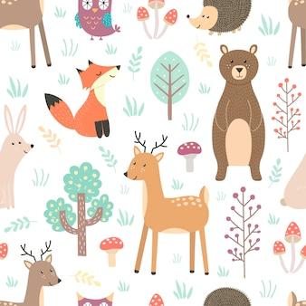 キツネ、鹿、クマ、ウサギ、ハリネズミ、フクロウのかわいい動物と森のシームレスパターン。