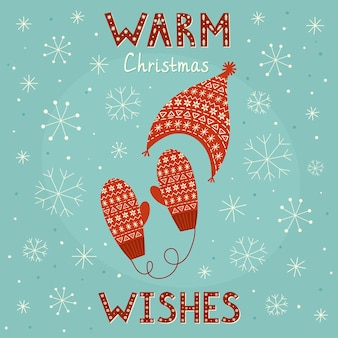 暖かいクリスマスは居心地の良いミトンと帽子のカードを願っています。