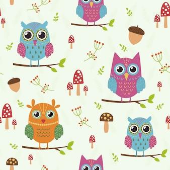 かわいいフクロウと森のシームレスパターン。
