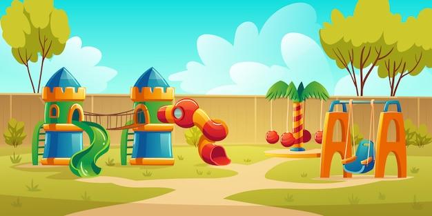 Детская площадка в летнем парке с каруселью