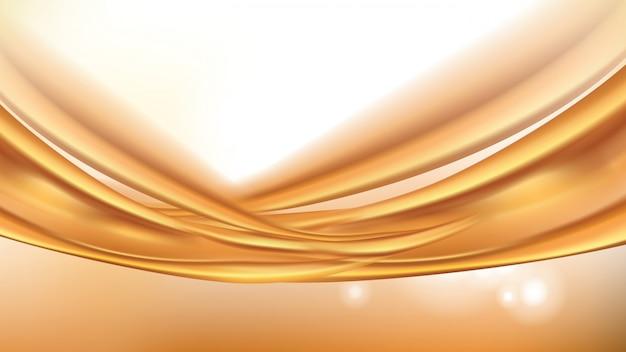 オレンジ色の黄金の流れる液体の抽象的な背景