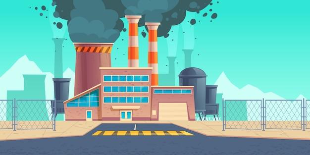煙突からの黒い煙で工場の建物
