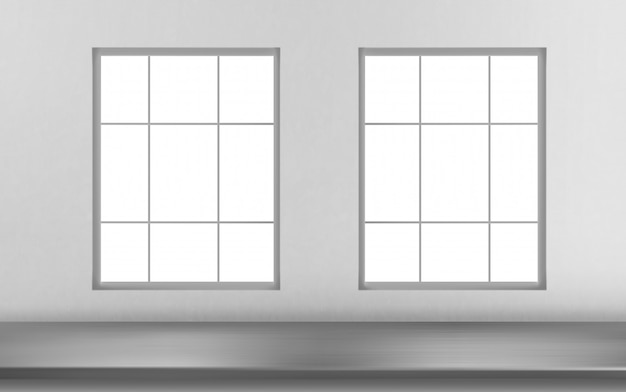 白い壁の窓のスチールテーブル表面前面