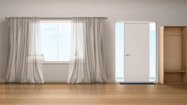 玄関ドアと窓のある家の廊下