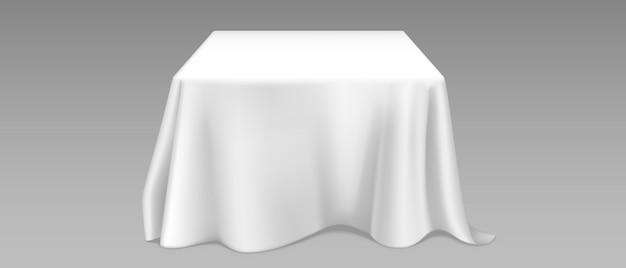 正方形のテーブルに現実的な白いテーブルクロス