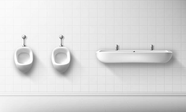 Керамический писсуар и умывальник в общественном мужском туалете