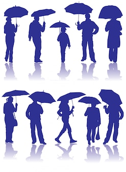シルエットの男性、女性、子供と傘