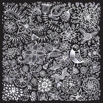 黒板の花と鳥にチョークで描かれました。