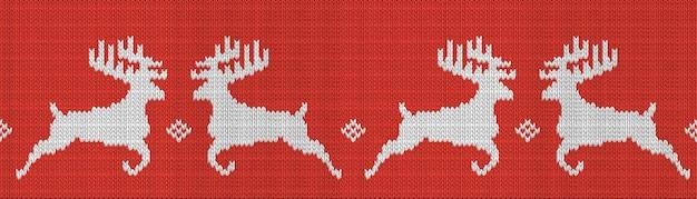 鹿とニットの赤いクリスマスのシームレスパターン