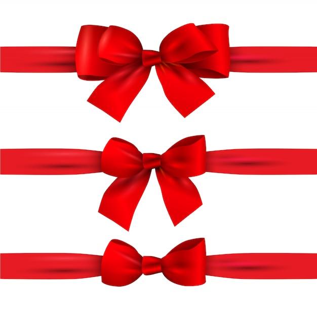 白で隔離される水平方向のリボンと赤の弓のセット