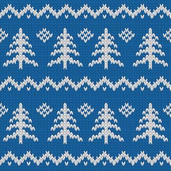 冬のクリスマスツリーとシームレスなニットブルーパターン