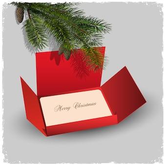 モミの枝とクリスマスカードと赤い封筒
